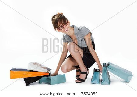 Young woman in red glasses admiring her shopping