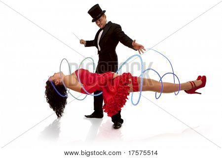 Magic moment - man performing magically levitating his assistant on white background