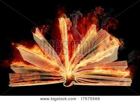 Opened burning book with fantail bright flaming sheets over on the black background