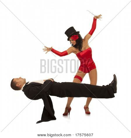 Magic moment - woman performing magically levitating her assistant on white background