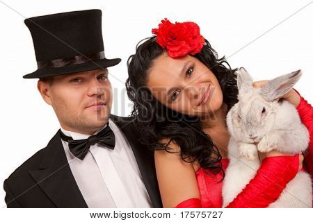 Closeup portrait of cute magicians with  bunny against white background