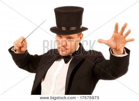 Magician performing a magic trick with magic wand over white background