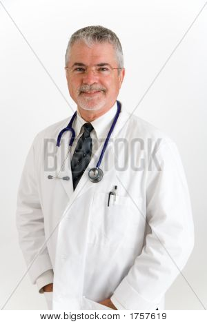 Happy Smiling Doctor With Hand In Pockets