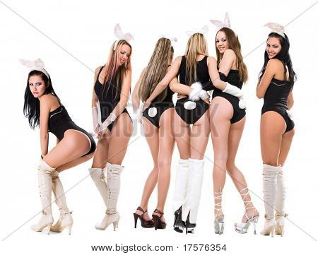 Sexy playgirls in bunny costumes isolated on white