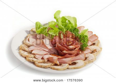 Big group of thinly sliced meat in the form of rose decorated with parsley and dill