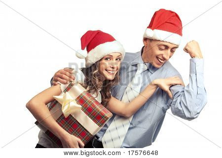 Young girl  with gift box checking out a man's biceps. Isolated over white background