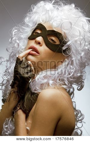 Close up shot of gorgeous Incognito woman in ancient style wig and mask