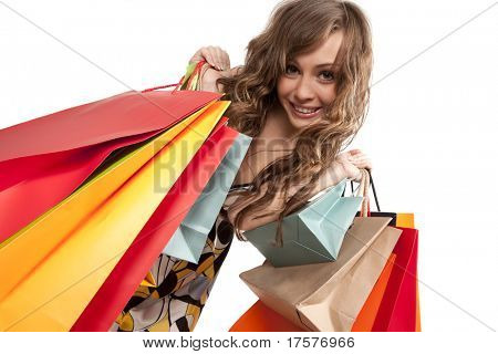 Pretty girl in red glasses admiring her shopping
