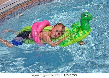 Boy Relaxing In Pool