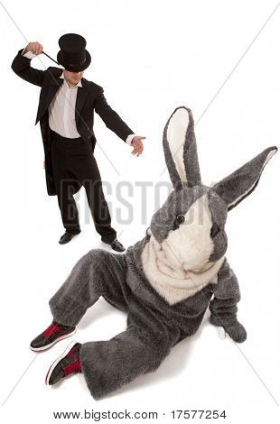 Luckless magician conjuring with a inconceivable rabbit over white background