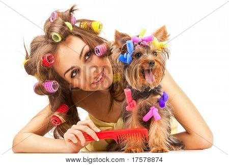 Shot of young adult female with Yorkshire Terrier dog