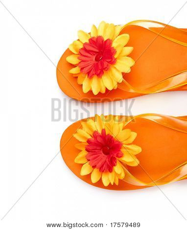 orange flip-flops with flowers on a white background close-up