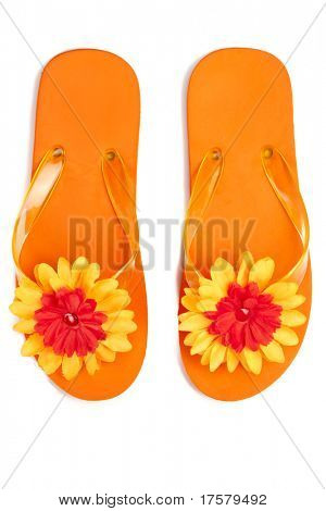 orange flip-flops with flowers on a white background