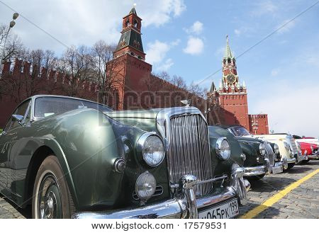"MOSCOW, RUSSIA - APRIL 24: Front of vintage Bentley car with Kremlin background at Vintage car rally ""The opening of the 2010 season"" on April 24, 2010 in Vasilevsky slope, Moscow, Russia"