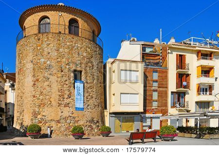 CAMBRILS, SPAIN - FEBRUARY 25: Torre del Port on February 25, 2011 in Cambrils, Spain. This defensive tower built in the seventeenth century houses nowadays a museum.