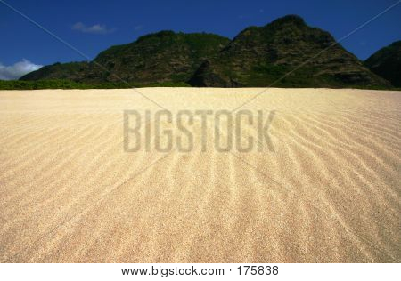 Rippled Sand Landscape With Mountains