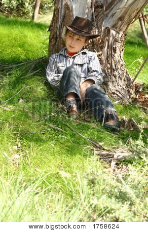Country Boy Sitting Under A Gum Tree