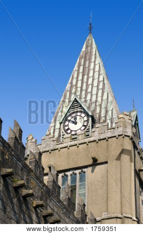Church Tower With Clock And Old Wall