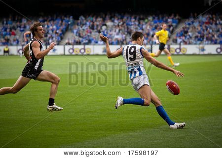 MELBOURNE - APRIL 2: North Melbourne's Sam Wright kicks during their loss to Collingwood at Etihad Stadium Docklands - April 2, 2011 in Melbourne, Australia