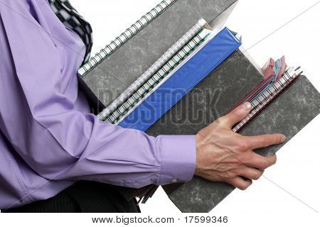 Businessman carrying a stack of files, concept for overwork, busy or multi-tasking