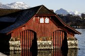 image of old boat  - Old wood and stone lake house with two boat garages - JPG