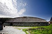 pic of longhouse  - A viking longhouse on the coast of Norway - JPG
