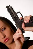 stock photo of girls guns  - Sexy young woman with a gun isolated on white - JPG