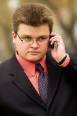 Young businessman talking by mobile phone