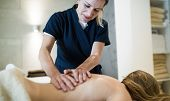 Therapist Massaging Patient At Wellness Spa poster