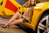 stock photo of luxury cars  - Beautiful woman with yellow sport car - JPG