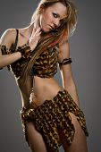 image of fluffing  - Portrait of a passionate amazonian woman fluffing up her hair - JPG