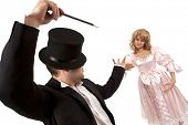 pic of dominant woman  - Performing magician with  marionette over white background - JPG
