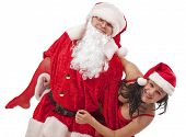 stock photo of promiscuous  - Portrait of Santa Claus with sexy girl in Santa hat - JPG