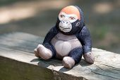 Toy Monkey On Timber poster