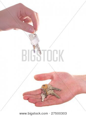A hand is giving and receiving a bunch of keys. Isolated over white.