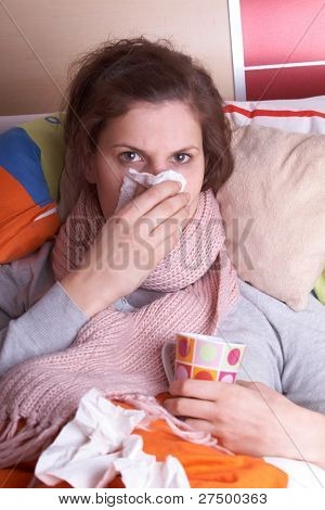 Young woman is ill in bed. She is feeling miserable. Ideal medical shot.