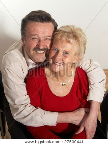 Happy old couple at home with copyspace.