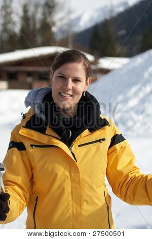 A young woman outdoor in a winter setting. The active woman is about to go crosscountry skiing.