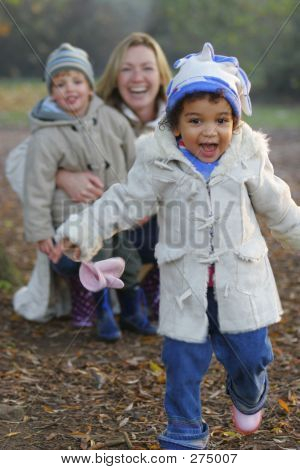 A Beautiful Mixed Race Girl Runs Towards The Camera Laughing Whi
