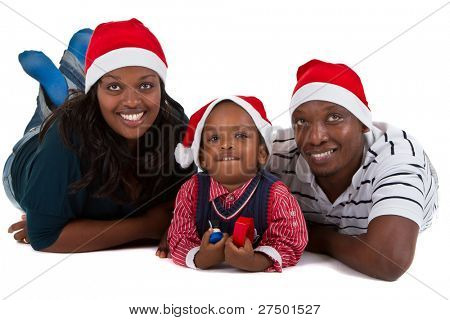 Young black family with a little boy are getting ready for christmas. Happy and cute image.
