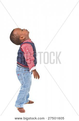 Young black baby boy looking up. Isolated over white background.