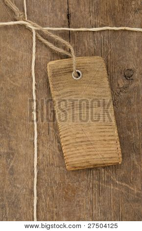 price tag over wooden board background