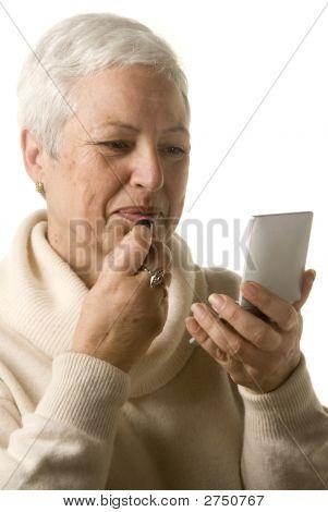 Woman Applying Lipstick