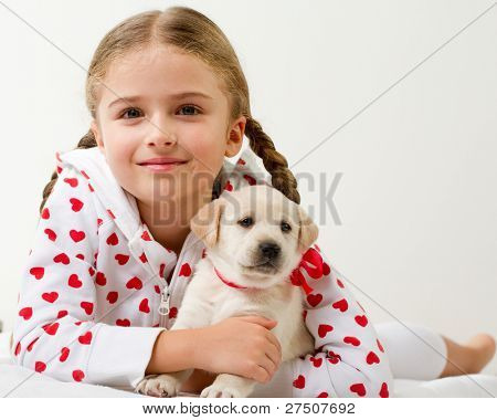 Best friends - happy girl with cute puppies