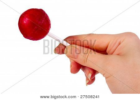 Red Lollipop In Female Hand
