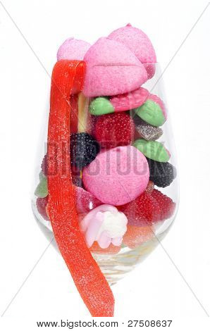 a glass with candies on a white background