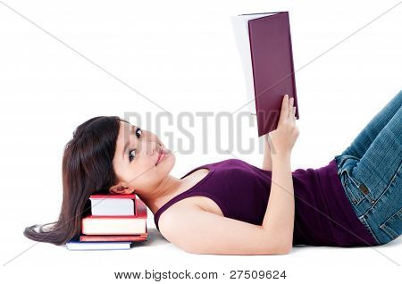 Cute Female Student Reading With Head Resting On Books