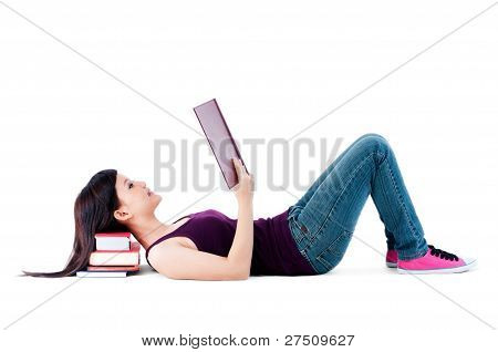 Young Female Reading With Head Resting On Books
