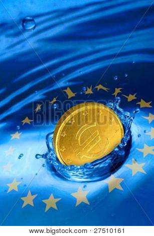 Golden euro coin falling to the water. European financial crisis metaphor.