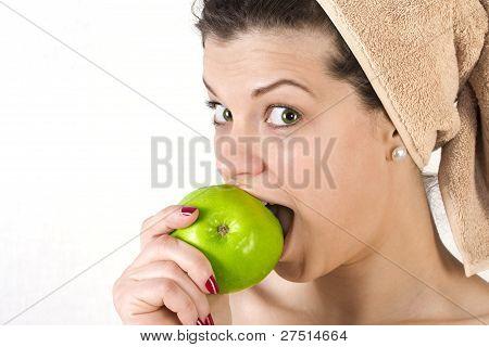 Beautiful Young Woman Beating An Apple.